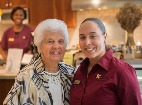 Senior living resident and staff